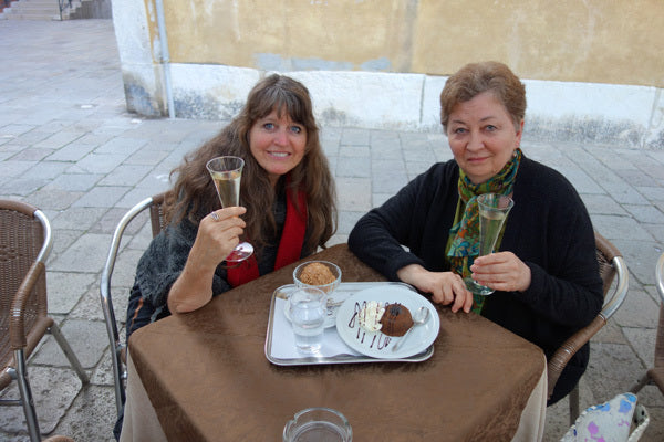 Venetian desserts and Prosecco Kelly and Dilya Two women dining in Venezia