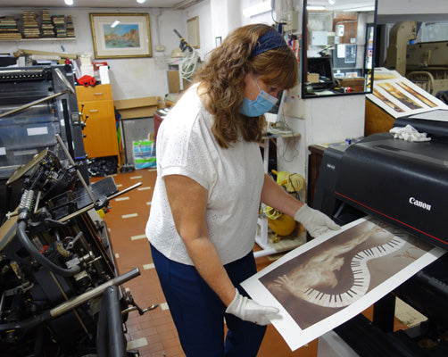 Artist Kelly Borsheim monitors art reproduction quality on Piano Keys