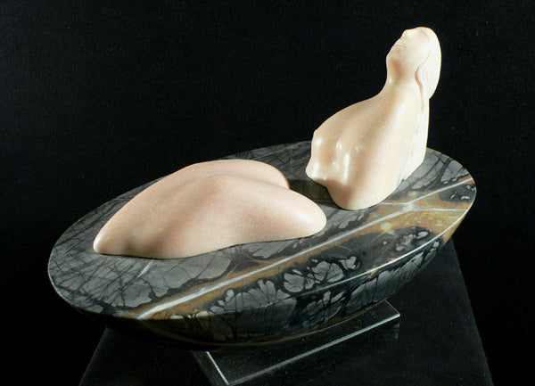 Land a figure in marble on a Picasso marble ellipital base sculpture