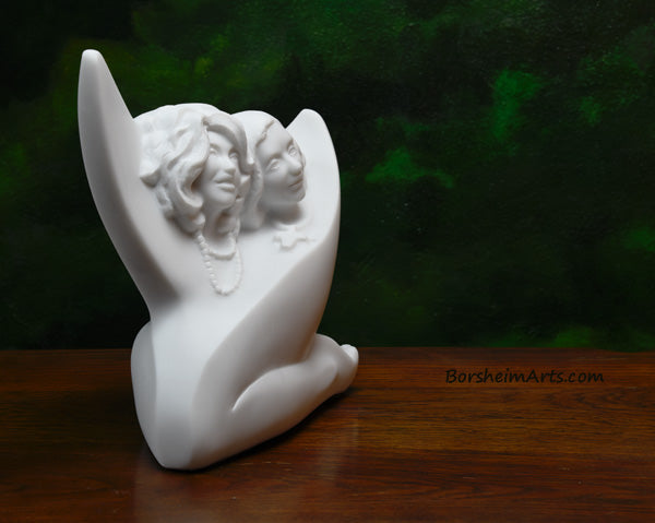 3/4 view Sisters, a commission stone carving portrait sculpture in white marble from Carrara, Italy