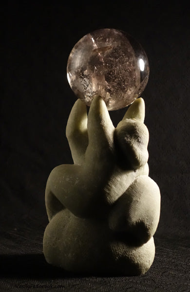 stone and glass crystal ball as a couple reaches to hold up the world sculpture by Vasily Fedorouk