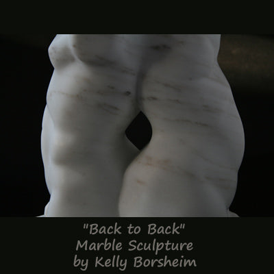 Back to Back marble sculpture of male and female torsos