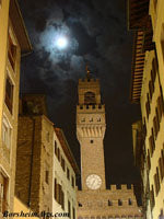 The Palazzo Vecchio in Florence, Italy, under a full moon
