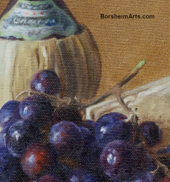 Detail of painted grapes with Italian bottle of Chianti wine