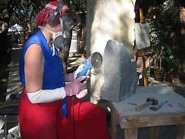 Sculptor Kelly Borsheim cuts stone Fish Lips with Diamond Blade. Photo by Jim Cayton.