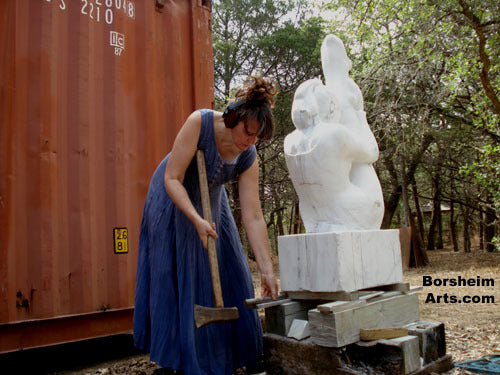 Sculptor Kelly Borheim raises her marble block to work with her back straight on lower parts of sculpture