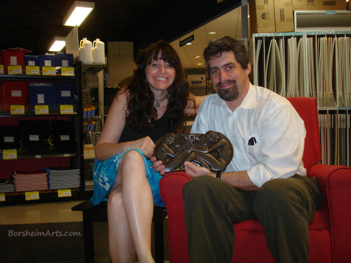 Artist Kelly Borsheim with client husband Jim with his 8th wedding anniversary gift for his wife with bronze sculpture.