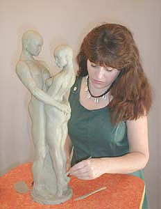 Artist Kelly Borsheim creating clay model for Together and Alone Bronze Sculpture
