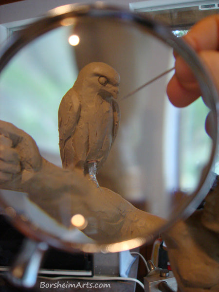Sculpting the Hawk using a magnifying glass to aid in the details Warrior Spirit