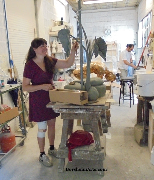 Artist Kelly Borsheim finishes clay sculpture before mold making foundry Pietrasanta