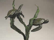 Load image into Gallery viewer, Detail of bronze sea turtles and kelp Sea Turtles seem to fly near a kelp plant. sculpture in bronze with limestone curvy hand-carved base that implies the sandy sea floor