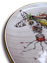 Load image into Gallery viewer, Detail of collector designer plate quality Miss Mushroom This fantasy drawing printed onto a porcelain and gold plate features the high-heeled shoe of Miss Mushroom (see top of shoe) and she is sure to delight!  Do you see red lips with tails, a serpent or snake, butterfly wings, zebra stripes, leopard design, tiny shoes, a bouquet of flowers, especially daisies, bats, and a spider web?