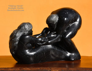 Helping Hands by Kelly Borsheim Couple Art Carved from a black marble called Bardiglio from Italy, this sculpture depicts a man bending over forward to help a seated woman stand up. Her hands reach up towards his bearded face, but it is the moment before she is close enough to reach him.