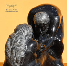 Load image into Gallery viewer, Another view of the man's bearded face in this black marble figure sculpture titled Helping Hands.  You may also see the textured waves in the woman's hair.