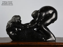 Load image into Gallery viewer, Helping Hands by Kelly Borsheim Couple Art Carved from a black marble called Bardiglio from Italy, this sculpture depicts a man bending over forward to help a seated woman stand up.  Her hands reach up towards his bearded face, but it is the moment before she is close enough to reach him.
