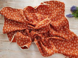Muslin Baby Swaddle Blanket Orange with White Rainbows