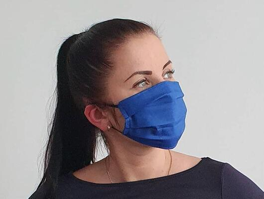 woman with cotton handmade reusable face mask face covering dark blue