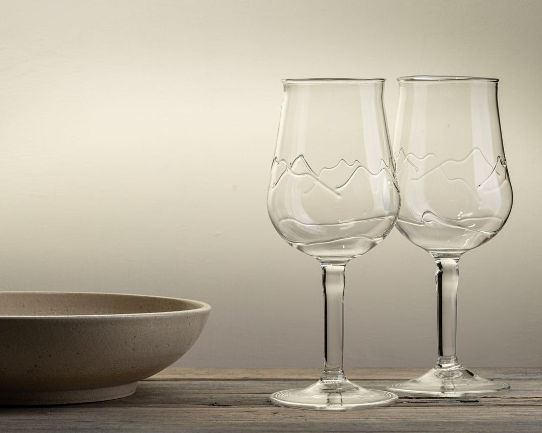 Handblown wine glass with mountain design