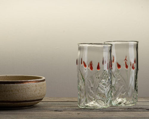 Handblown glass tumbler with leaf and bud design