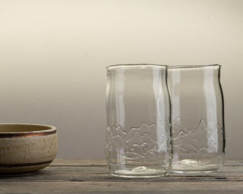 Handblown glass tumbler with mountain design