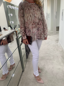 Pink snake print crinkle blouse with long sleeves.
