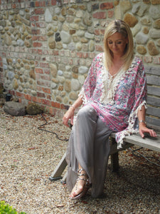Pink floral Kaftan trimmed with cream crochet.