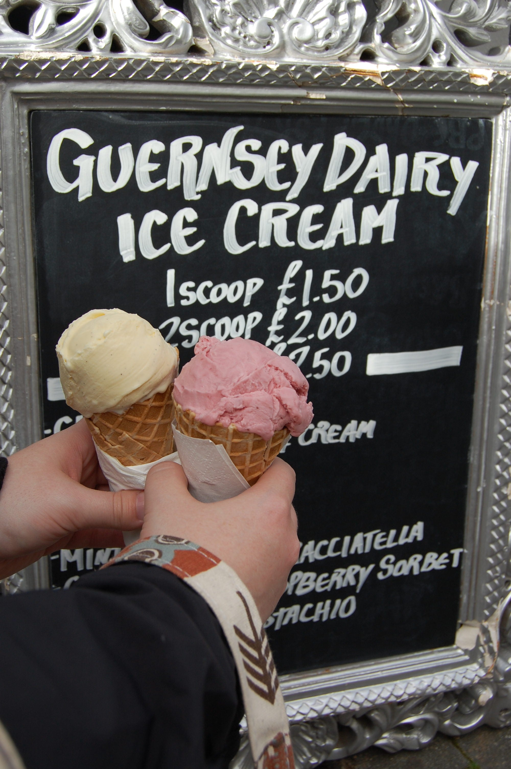 literary travel, Guernsey ice cream, ice cream in front of sign, Guernsey cow