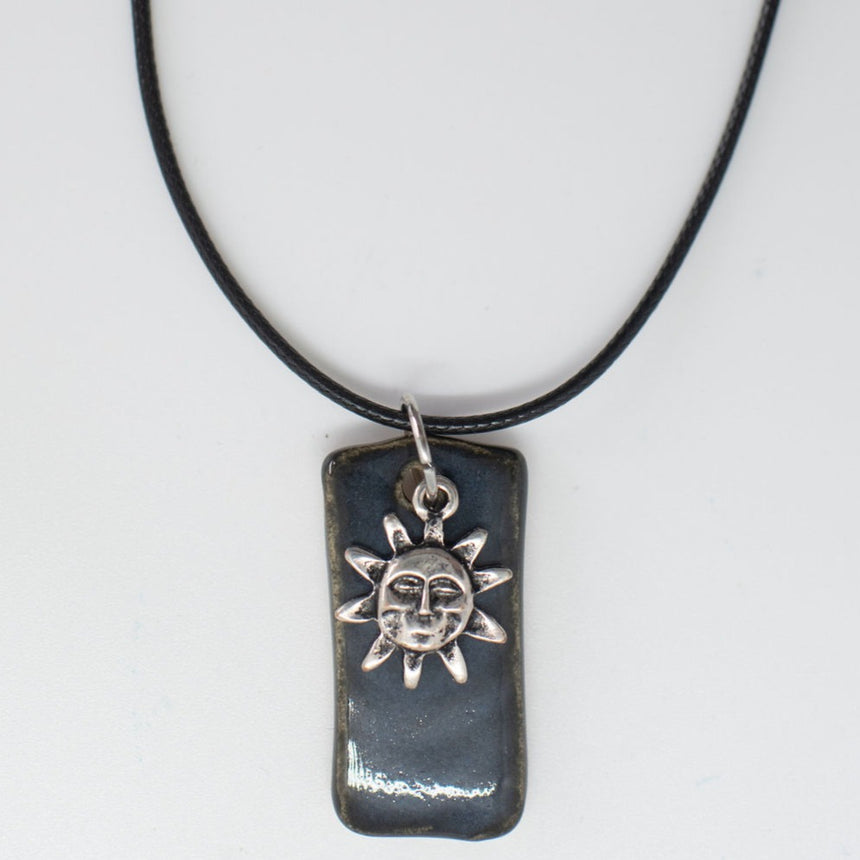 Sunshine Over Deep Ocean Pottery Pendant
