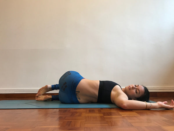 supine twist - poses for period pains - ohsosom