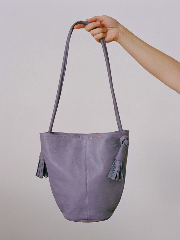 Leather bag with adjustable handles and tassels by Paloma Wool