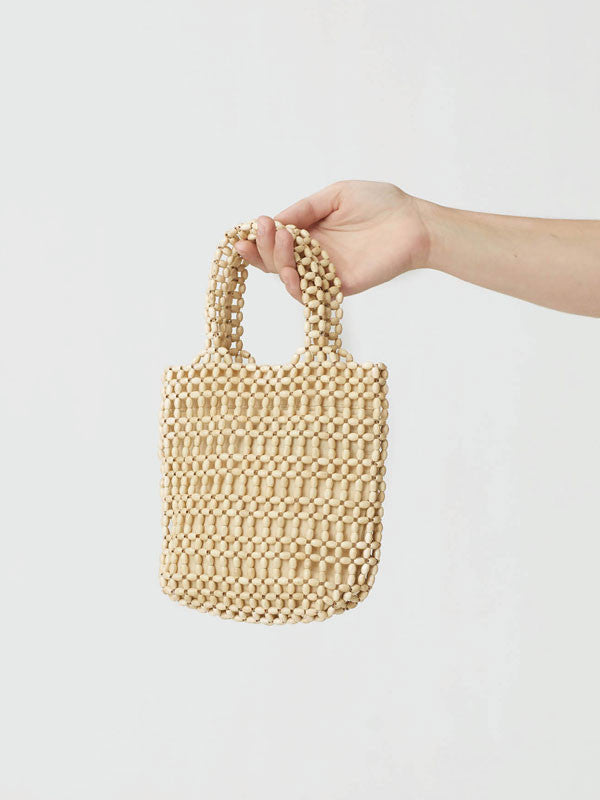 Handmade wooden handbag by Paloma Wool