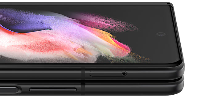 Folded Galaxy Z Fold3 5G seen from the open side. A colorful wallpaper is seen on the Cover Screen, and it turns slightly until only the edges show, to demonstrate how thin Corning® Gorilla® Glass Victus™ is.