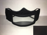 A black cotton face mask featuring a plastic window over the mouth to help the wearer communicate with people who rely on reading lips. A small black rectangle is in the bottom right corner.