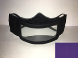 A black cotton face mask featuring a plastic window over the mouth to help the wearer communicate with people who rely on reading lips. A small purple rectangle is in the bottom right corner.