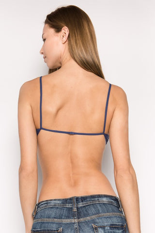 Lace triangles, with thin straps and bust detail, almost bareback, and elastic band around the bust bralette. No padding.