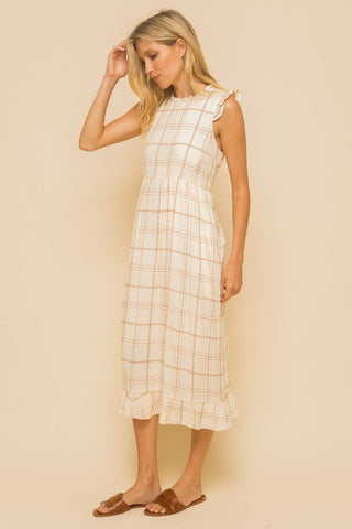 SOFT LOOSE BUT INCREDIBLY FLATTERING CREAM AND BROWN PLAID RELAXED FIT DRESS WITH RUFFLE HEM AND SHOULDER DETAIL.