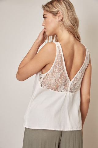 SUPER BEAUTIFUL SOFT CHAMPAGNE COLOR TEXTURED SILKY TANK. LACE DETAIL ON STRAPS, BUST, AND BACK.