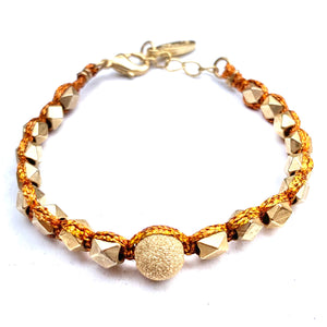 GOLD AND COPPER KNOTTED BRACELET