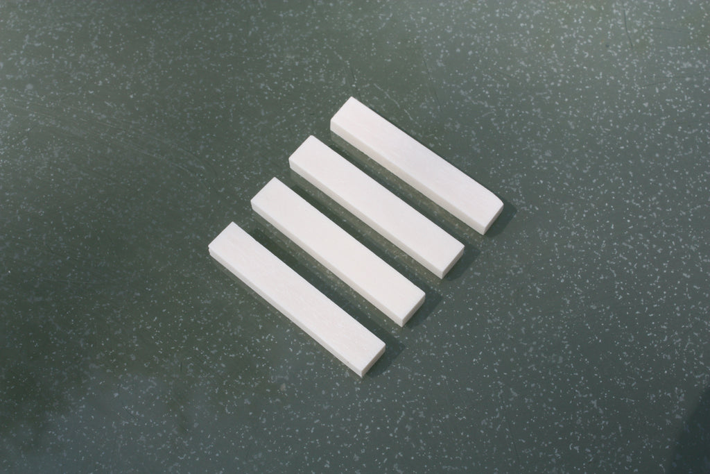 Bone nut blanks, available for 3 and 6 string guitars.