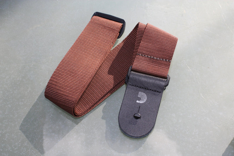 Guitar strap brown made from polypropylen. Made by d'Addario.