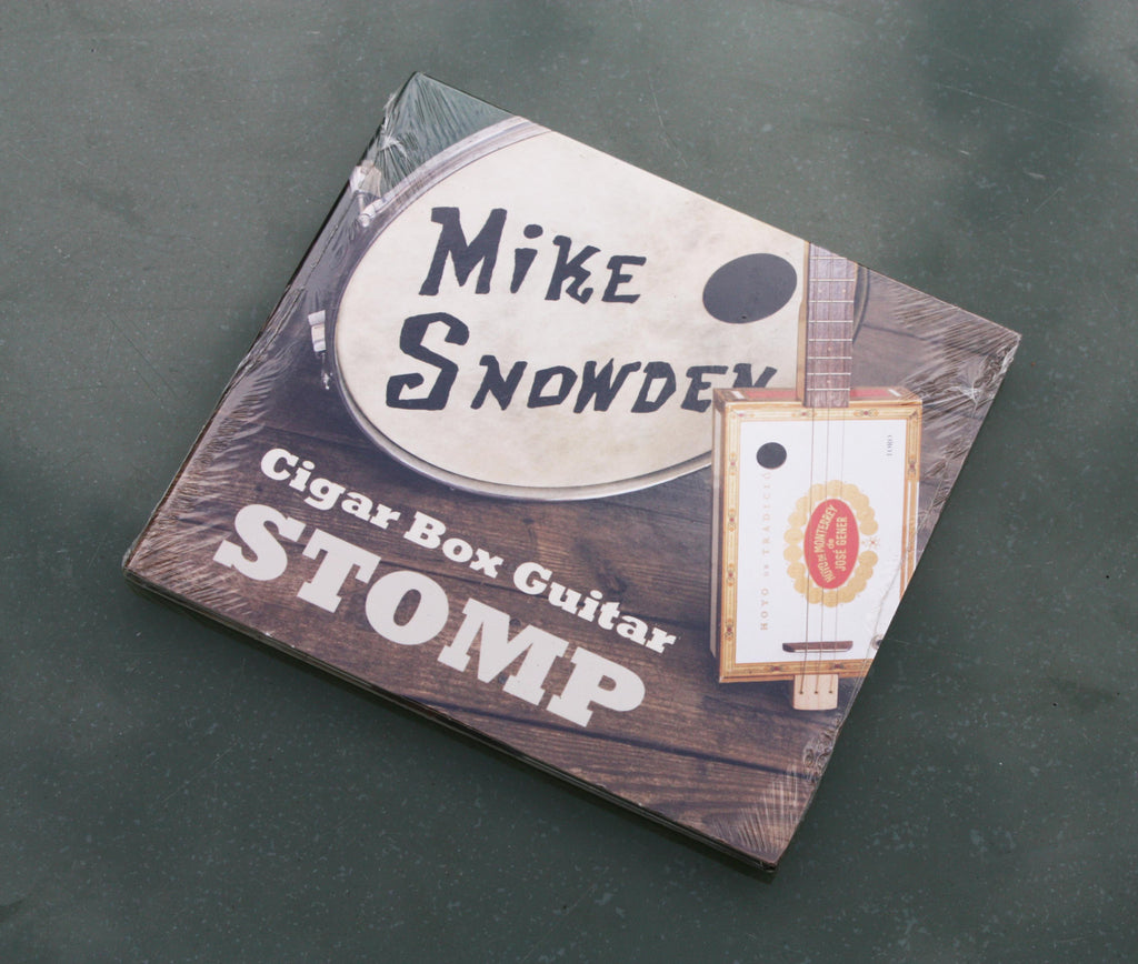 "Mike Snowden - ""Cigar Box Guitar Stomp"" featuring 10 tracks."