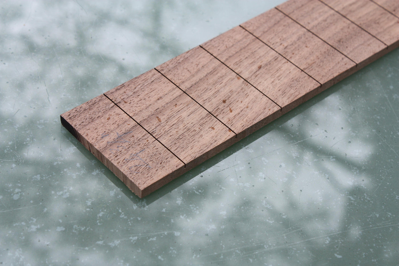 Wide slotted fretboard, suitable for 6 string guitars. Made by ...