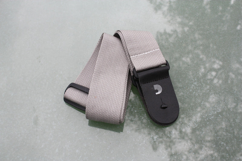 Guitar strap grey made from polypropylen. Made by d'Addario.