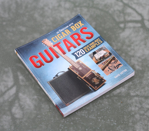 An Obsession With Cigar Box Guitars. Source book for building your own cigar box guitar.