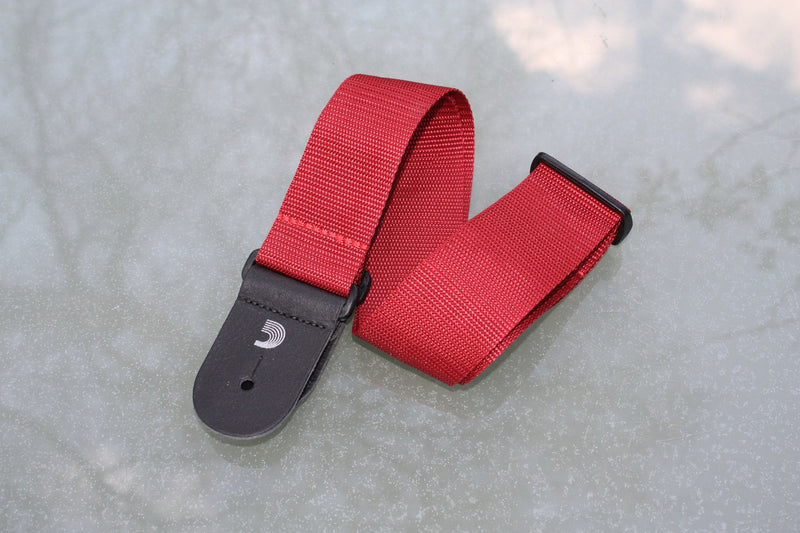 Guitar strap red made from polypropylen. Made by d'Addario.