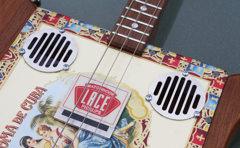 Steel soundhole trims (pair), art deco slotted on cigar box guitar, fixing screws included.