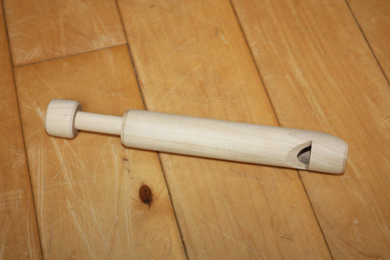 Wooden swanee/slide whistle made by House of Marbles.