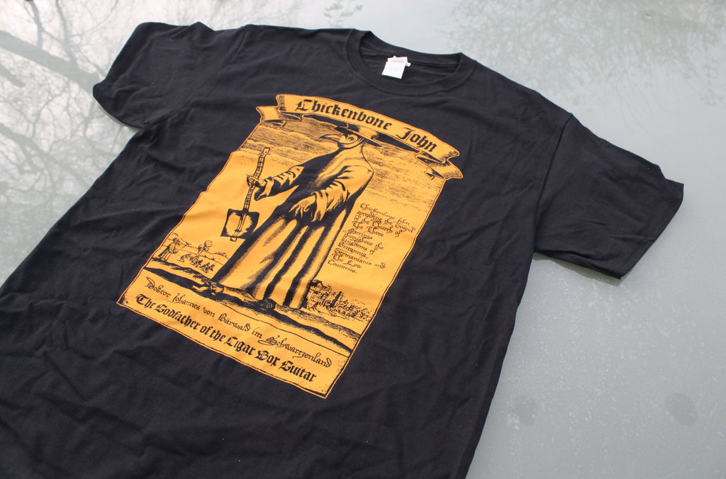 ChickenboneJohn T-Shirt with Plague Doctor design. AMber on black, with small logo on the back. 100% cotton.