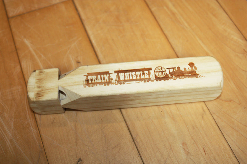 Wooden train whistle made by House of Marbles.