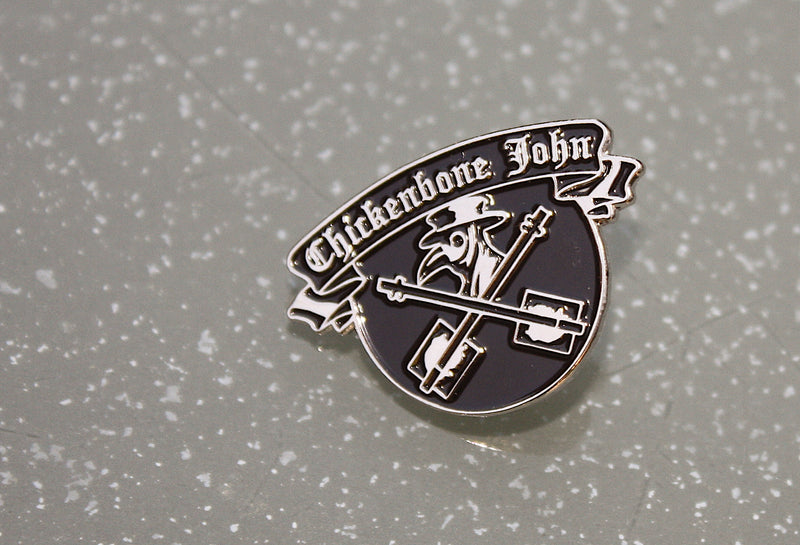 Chickenbone John metal pin badge